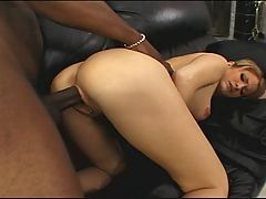 Ebony stud sticking it to a sexy white babe on the sofa